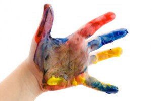 Childrens hand in the paint
