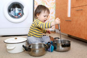 baby playing with pots