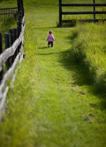 Baby girl walking through path
