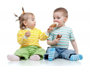 happy children little girl and boy with ice cream in studio isol