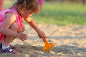Little girl playing in the sandpit