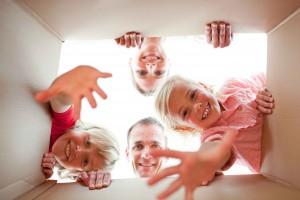 Joyful family unpacking boxes